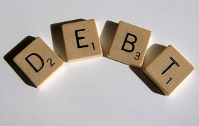 Post image for The Knockout Combo: How to Beat Credit Card Debt Once and for All